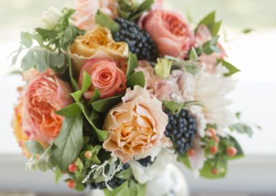 coral, peach, navy bridal bouquet with garden roses